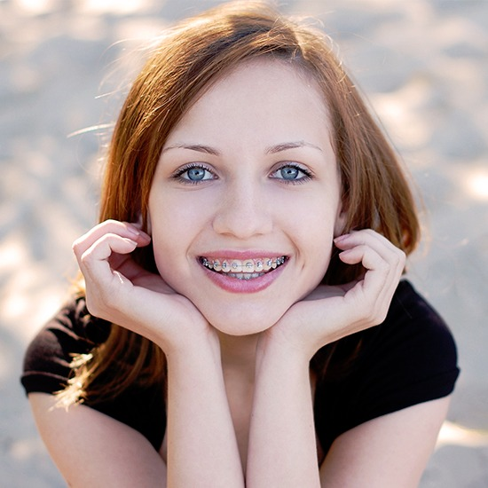 Teen girl with traditional braces