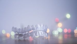 Closeup of Invisalign in Marlborough with Christmas lights in background